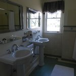 Large bathroom with double pedestal sinks