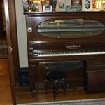 The antique player piano in the parlor