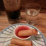 Spring rolls and a Thai iced coffee
