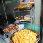 Freshly fried chips and roasted nuts