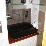 Bathroom sink in room 615. Lots of cabinet space in the drawer below!