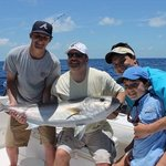 Big Amber Jack needed the entire family to haul it in! Great memory for years to come.