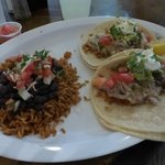 Pork tacos with beans and rice