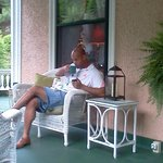 My husband enjoying a cup of tea on the front porch