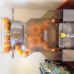 Freshly squuesed Orange Juice machine