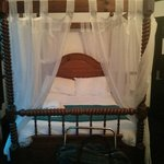 The four poster bed .