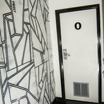 room O door and artwork throughout -The Dictionary Hostel, Shoreditch, East London