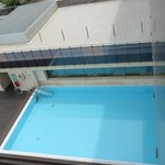 Outside pool shaded by building