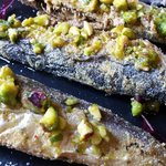 Sardinas: Crispy, Pan Fried Sardines Drizzled with a Pistachio Infused Olive Oil.