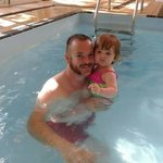 My husband and daughter in the hotels pool