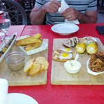 Olives, potato wedges, duck rillette, quail egg & duck canape, tuna tataki, corn & calamari