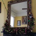 mirror over mantle in dining area