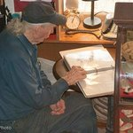 Jack looking thru his many books of letters and memories.