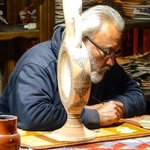 Elderly gentleman drawing designs for pottery