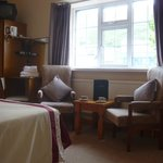 Seating area in the rooms also has dressing table and chair
