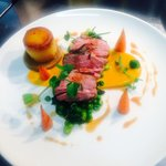 Roast lamb rump, carrot purée, broadies, peas, potato fondant