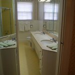 Private Bath for the Green Room with double vanity sink and heated tile floor