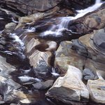 Salmon Falls flowing over glacial potholes from dam.