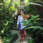 Nyoman's lovely wife Putu placing offerings