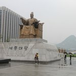 Statue of King Sejong with Gwanghwamun in the background