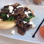 sliced field mushrooms sauteed with garlic butter, red onion, baby spinach, and danish feta