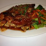 Half roasted duck with stir fry veg and a sweet chilli that sauce