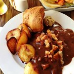Slices of roast lamb under all that delicious gravy, crisp crackling on top. Too good!