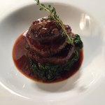Medallion of fillet steak with Porto sauce on a bed of sautéed spinach served with field mushroo