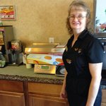 Excellent hostess standing beside the magic pancake machine!!