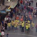 Parade passing below the EStudios