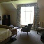 bedroom with window overlooking water-spectacular view