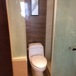Our deluxe king room (bathroom photo) which smelt of horrible cigarettes! So much for booking a