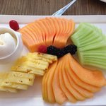 Fruit platter with frozen sweet cream.
