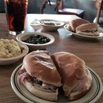 Ham sandwich, potato salad and turnip greens