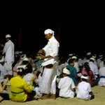 Locals Praying on the Beach at night