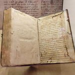 From the exhibit on end papers. Here, pages from an older book are used to protect the book's co