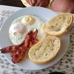 Eggs with bacon and bread