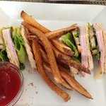 Club sandwich w/fries (this is only half of it - other half eaten)
