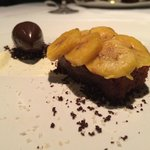 Desert. Sour Caramel Biscuit with plantains. Cacao Gelato.