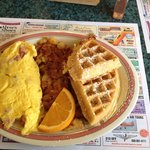 Combo ham & cheese omelette with half granola waffle and hash browns