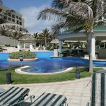 Additional pool with swim up bar.