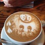 Owl or penguin coffee art in a mocha