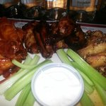 Sweet heat, wasabi teriyaki, and Caribbean jerk wings served with celery and ranch or bleu chees