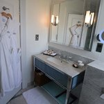 Robes and sink in standard room at The Caledonian, Edinburgh, Scotland.