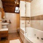 The en suite bathroom with jacuzzi bath.