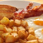 Eggs Bacon homefries and toast