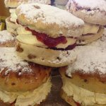 Filled with fresh cream and topped and tailed with jammy loveliness
