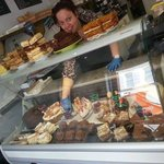 The lovely Sarah showing off the cake cabinet 🍰