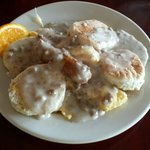 Biscuits and gravy with eggs on it. Delicious