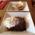 Homemade bread and butter pudding (top) and sticky toffee pudding. Both delicious